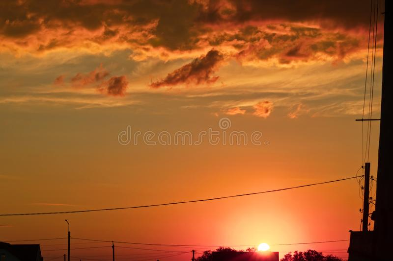 Beautiful abstract colorful background. Dramatic sunset like fire in the sky with golden and red clouds. Selective focus stock image