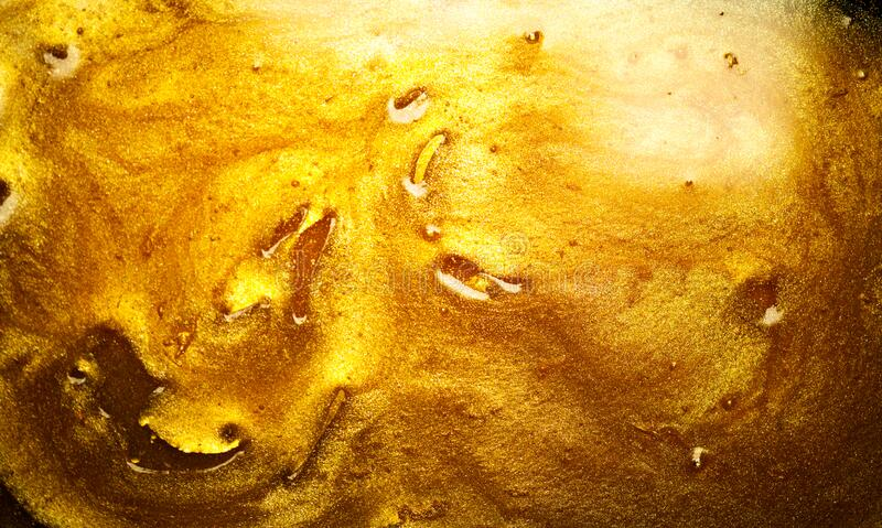Beautiful abstract golden liquid background, beauty gold backdrop texture. Metallic gold paint. Yellow shimmering surface stock photography
