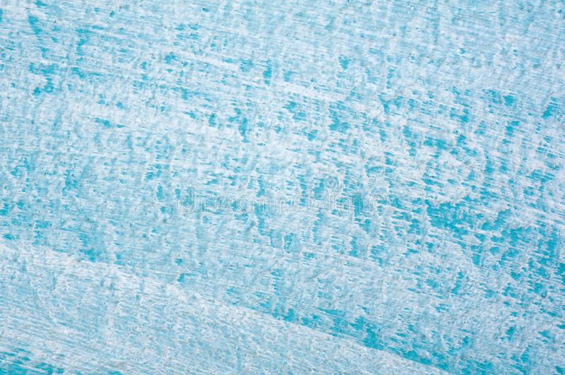 Beautiful Abstract Grunge Decorative Light Blue Cyan Painted Stucco Wall Texture. Handmade Rough Winter Christmas Paper Wide stock photo