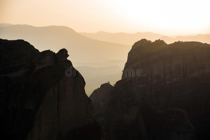 Beautiful abstract landscape with mountain outlines in the famous Meteor Valley, Fesqualia, Greece at sunset. royalty free stock photography