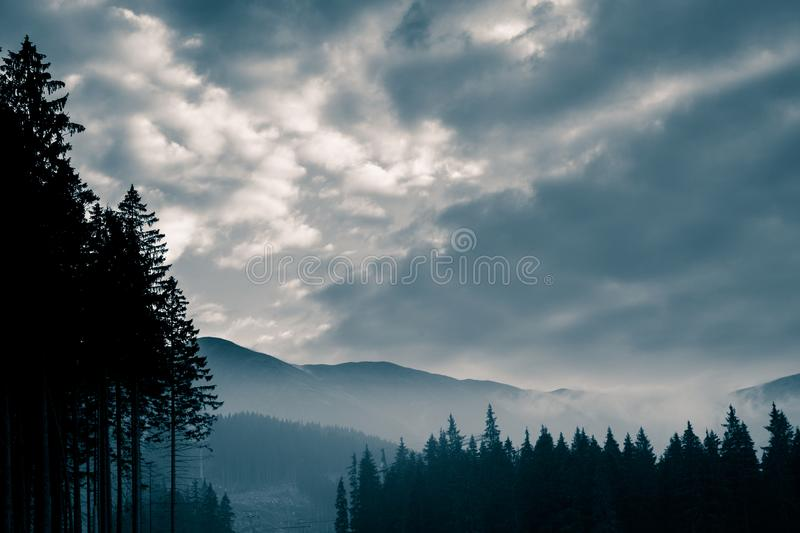 A beautiful, abstract monochrome mountain landscape in blue tonality. Decorative, artistic look in black and white style royalty free stock photography