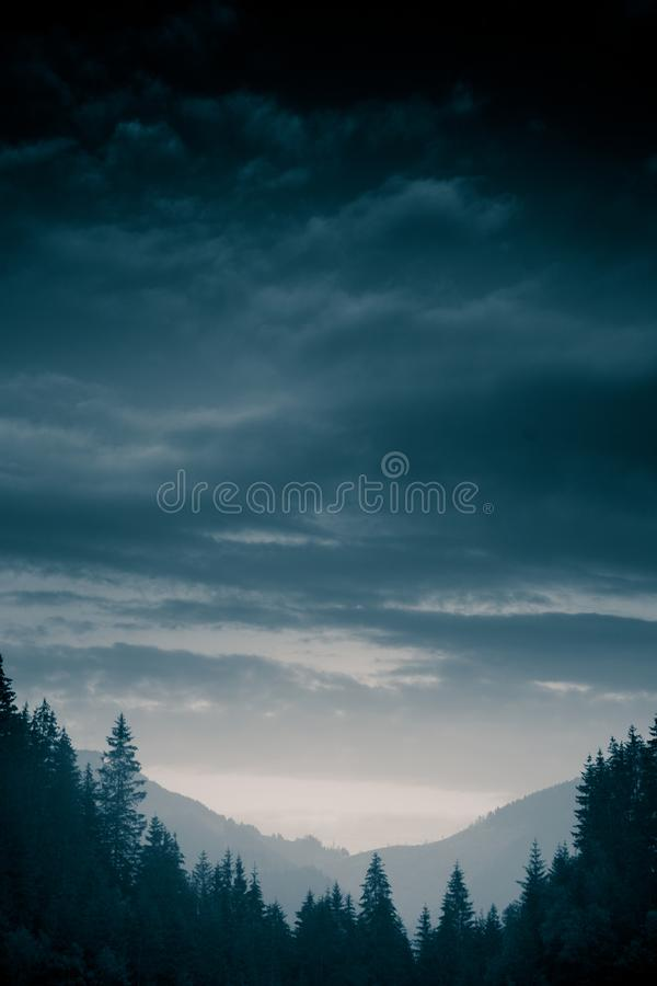 A beautiful, abstract monochrome mountain landscape in blue tonality. stock image
