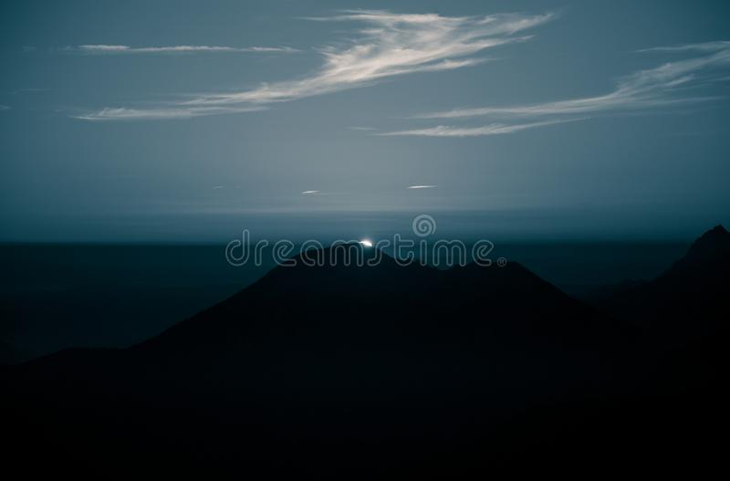 A beautiful, abstract monochrome mountain landscape in blue tonality. Decorative, artistic look in black and white style royalty free stock image