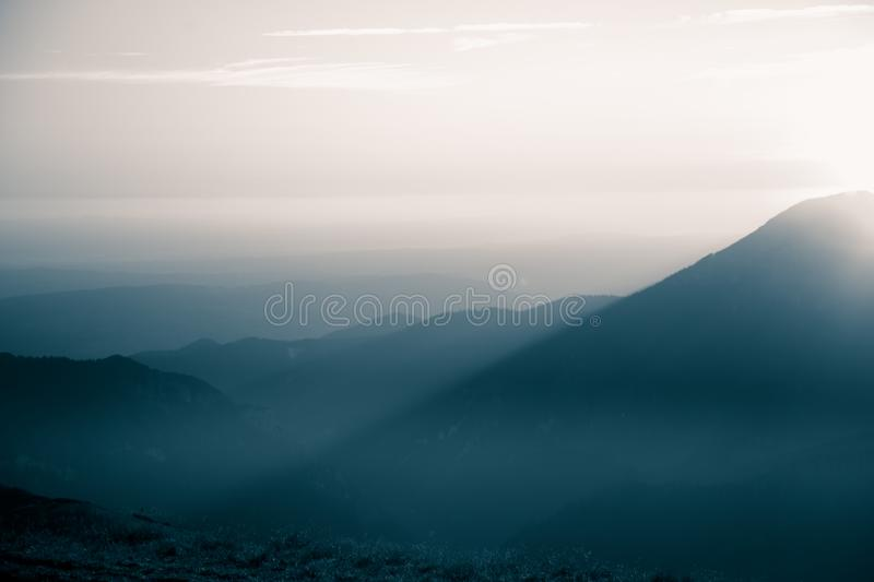 A beautiful, abstract monochrome mountain landscape in blue tonality. royalty free stock photography