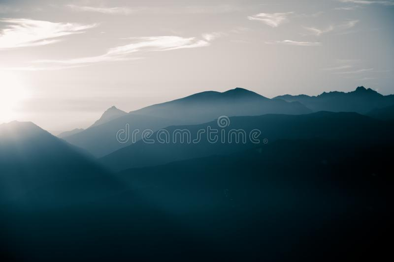 A beautiful, abstract monochrome mountain landscape in blue tonality. Decorative, artistic look in black and white style royalty free stock images