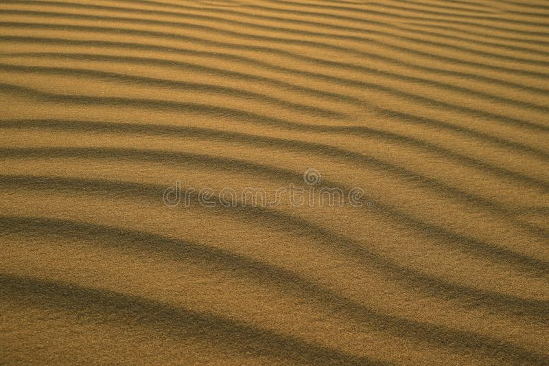 Beautiful abstract pattern of desert sand ripples in the evening sunlight at Huacachina sand dune in Peru stock photo