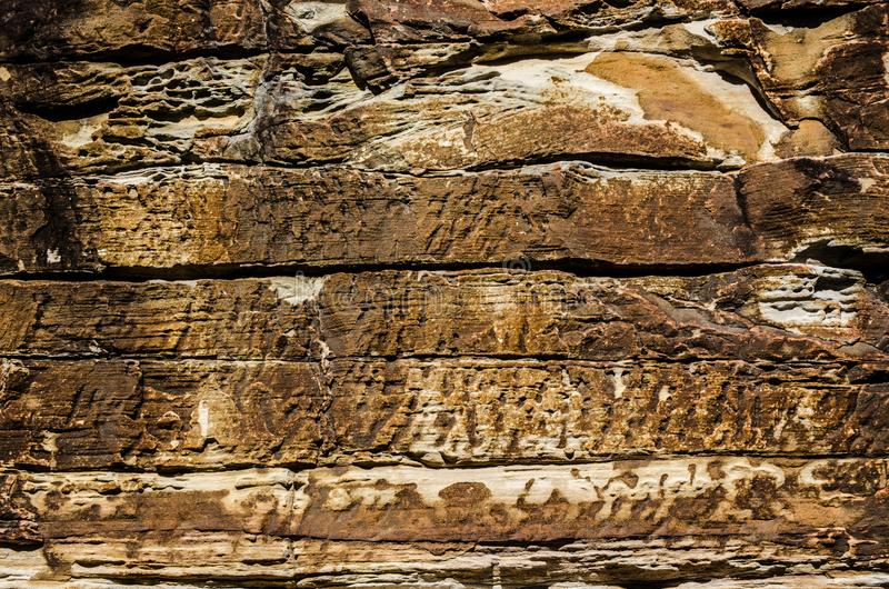 Beautiful abstract patterns of Natural red stone grunge cave wall. stock images