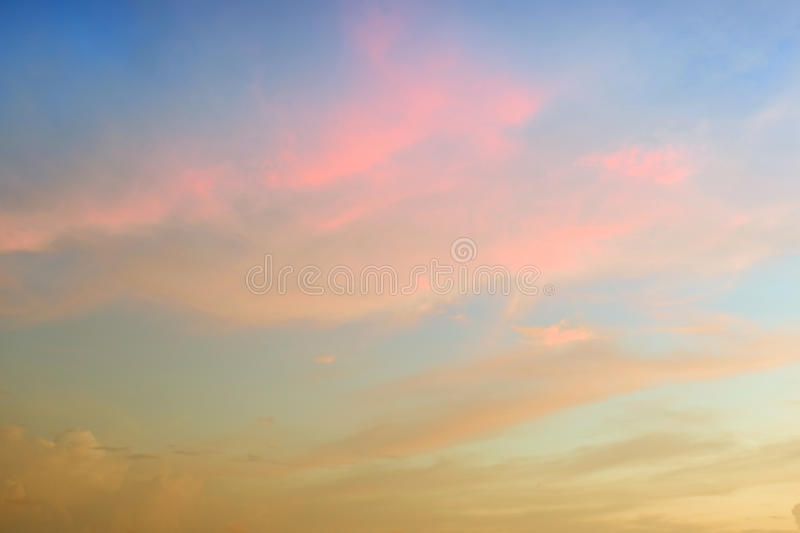 Beautiful abstract sky with pink and yellow clouds. Beautiful abstract sky at sunset with pink and yellow clouds royalty free stock photos