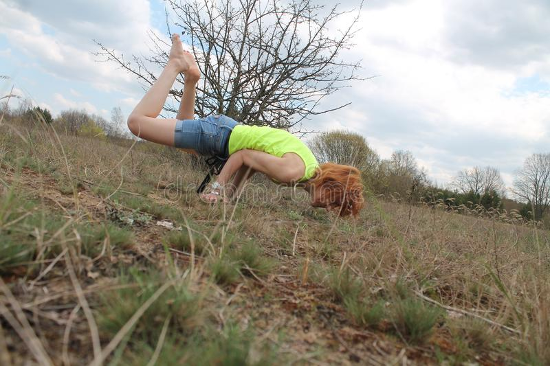 Active woman. Beautiful active flexible woman made yoga class on the nature stock photography