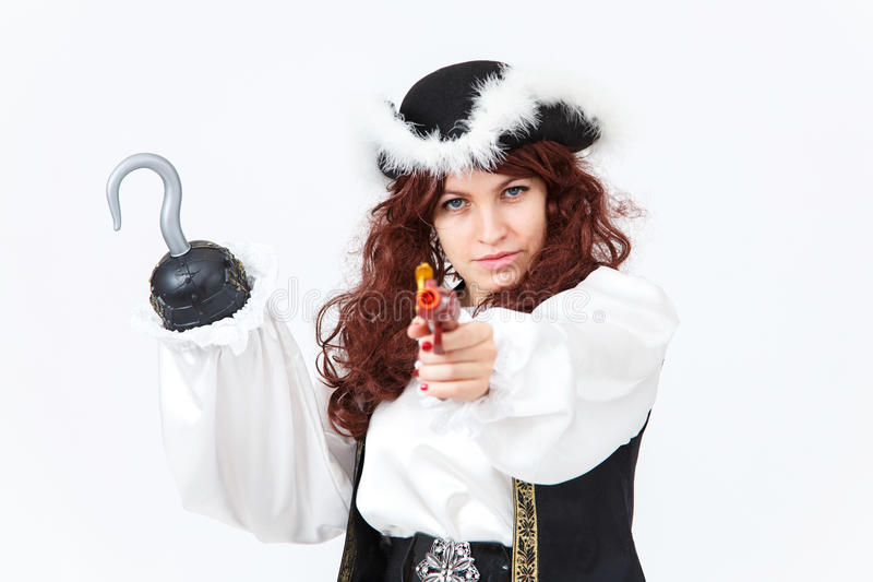 Beautiful actress in pirate costume with pistol and hook stock image