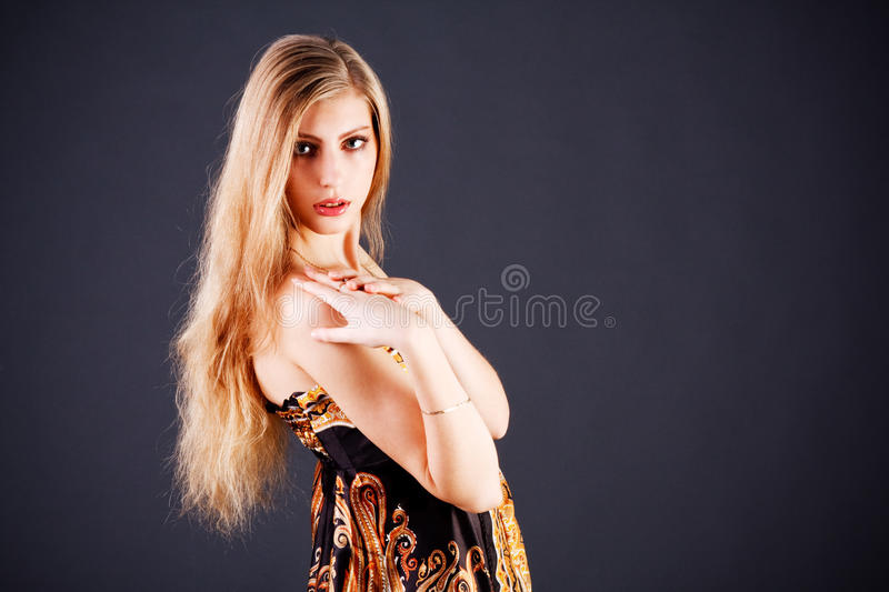 Beautiful adorable blond girl in dress stock photography