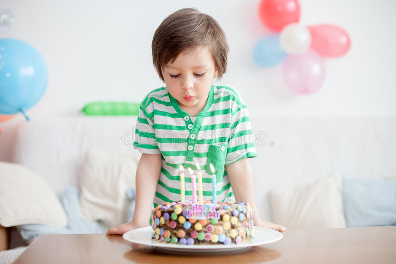 Beautiful adorable four year old boy in green shirt, celebrating royalty free stock photography