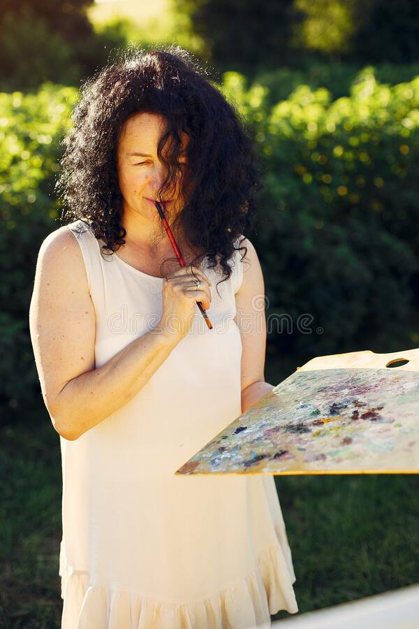Free Beautiful Adult Woman Drawing In A Summer Field Royalty Free Stock Photography - 216739807