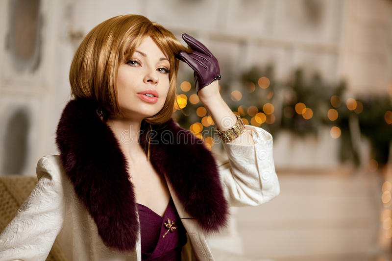 Beautiful adult woman in winter coat with fur. Trendy modern bl. Beautiful adult woman in a winter coat with fur. Trendy modern blondy girl with short hair royalty free stock photo