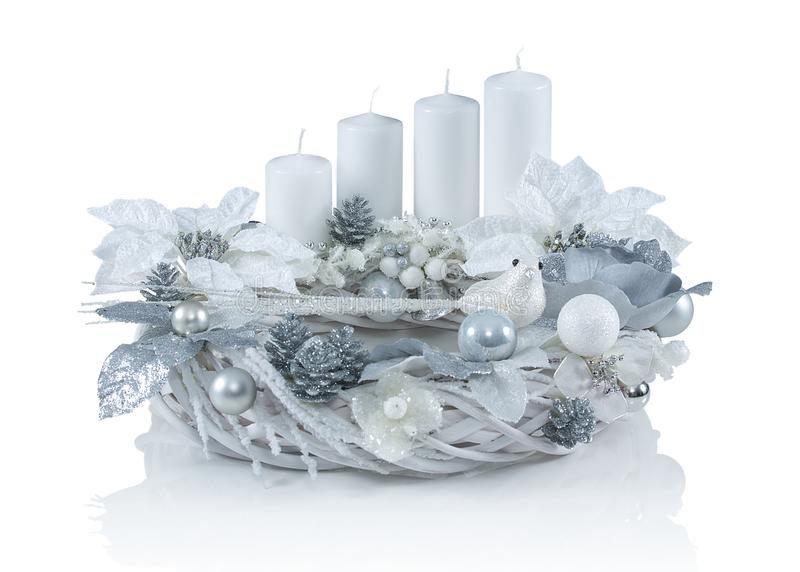 Beautiful advent wreath with four white candles and various ornaments isolated on white background with shadow reflection. Christian traditional decorated stock photography