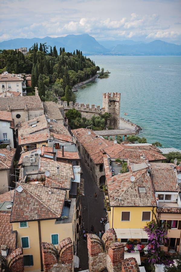 Beautiful aerial city view on Garda Lake, Sirmione, Italy. Beautiful aerial city and mountains view on Garda Lake, Sirmione, Italy from Scaligers castle stock photos