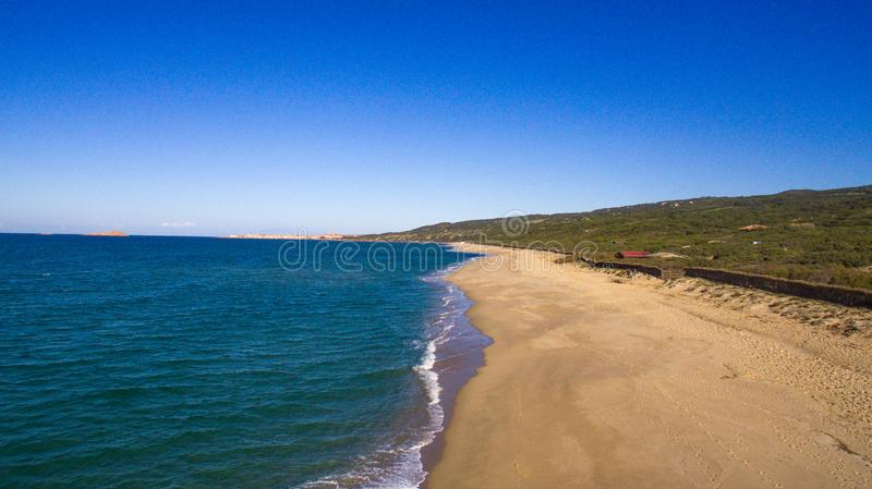 Beautiful aerial panorama with the drone of the famous beaches at the Sardinian sea with the isola rossa and castelsardo behind royalty free stock photo