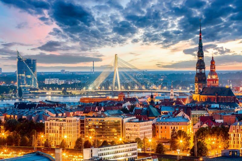 Beautiful aerial panorama of Riga center and Vansu bridge over Daugava river during amazing sunset. View of illuminated Riga city stock photos