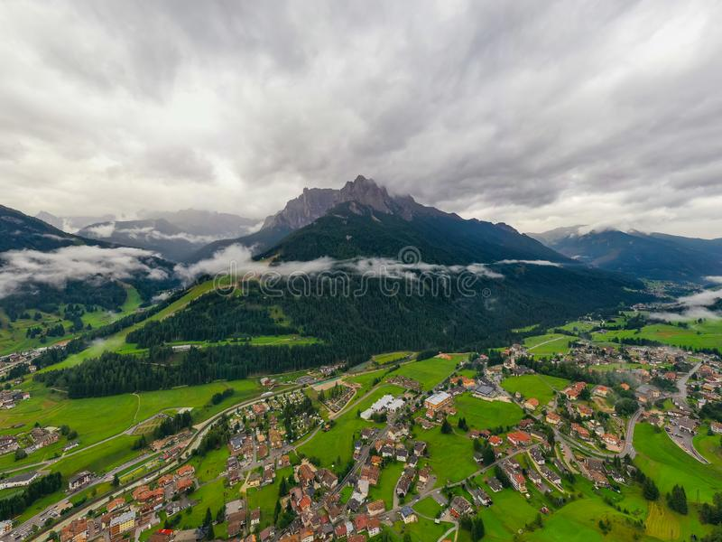 Beautiful aerial panoramic view of the Dolomites Alps, Italy. Mountains covered by clouds and fog. Catinaccio mountain ranges. stock photo