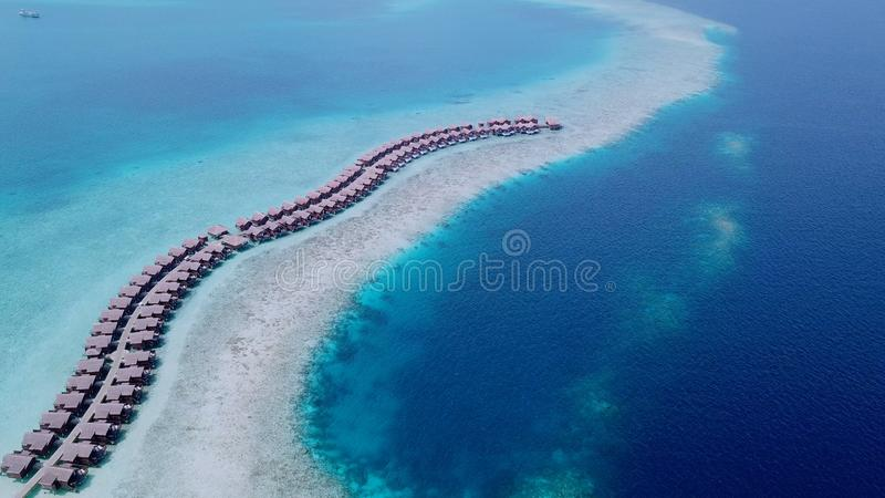 Beautiful aerial shot of row bungalows along beach royalty free stock image