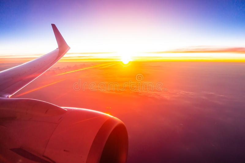 Beautiful aerial view from airplane wing on white cloud and sky at sunset time. Beautiful aerial view from airplane wing on white cloud and sky at sunset or royalty free stock photography