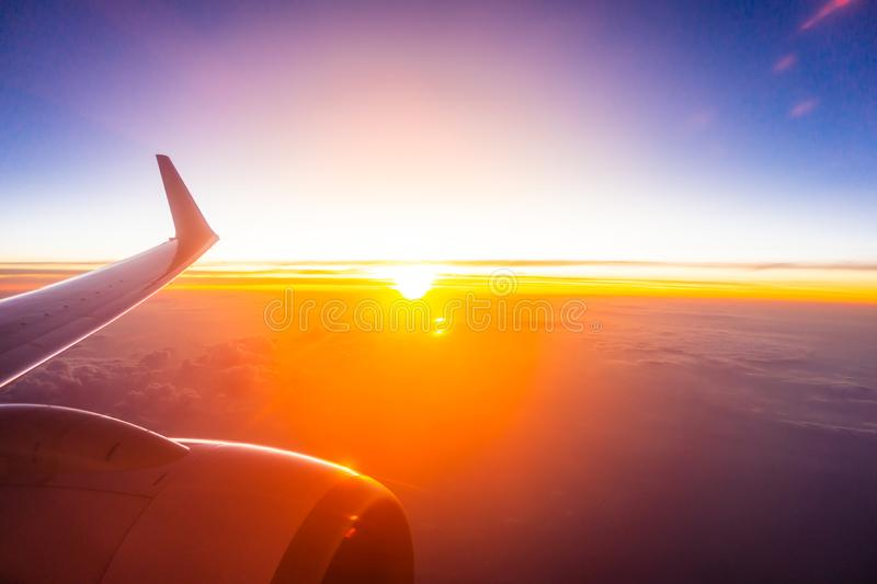 Beautiful aerial view from airplane wing on white cloud and sky at sunset time. Beautiful aerial view from airplane wing on white cloud and sky at sunset or stock photography