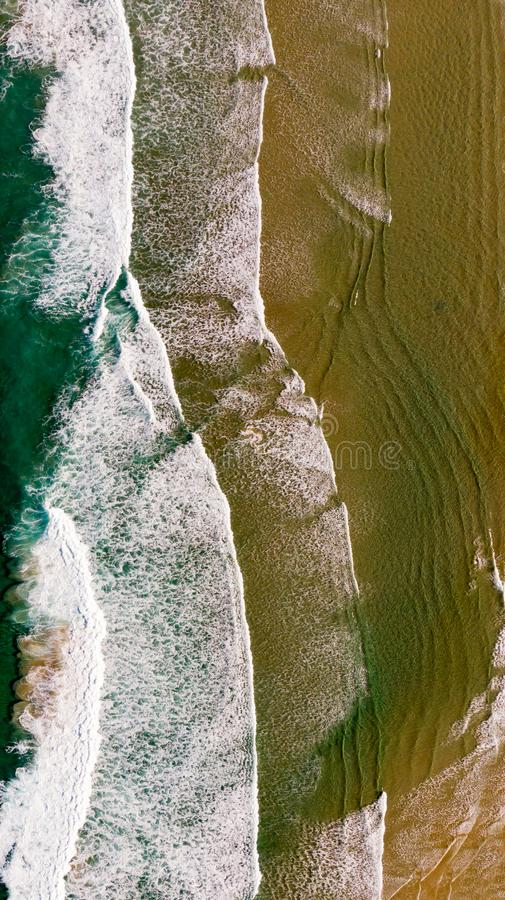 Beautiful aerial view of a beach with waves royalty free stock image