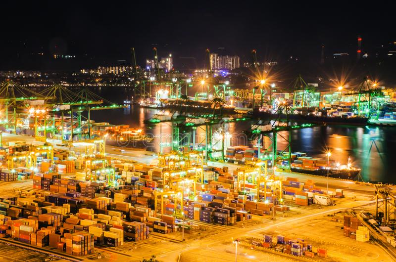 Beautiful aerial view of busiest Asian cargo port with hundreds of ships loading export and import goods and thousands. Singapore. November 26, 2018: Beautiful stock photography