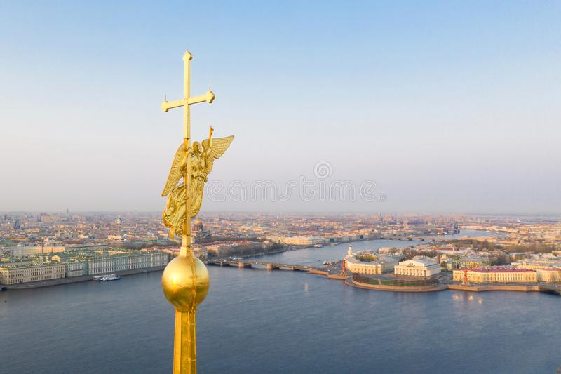 Beautiful aerial view on the center of winter Saint Petersburg city through the Angel of Peter and Paul Cathedral.  royalty free stock photo
