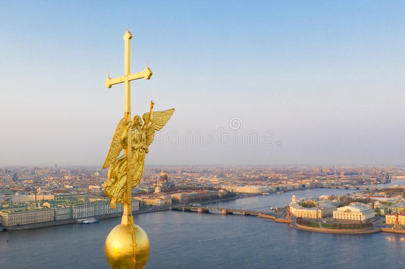 Beautiful aerial view on the center of winter Saint Petersburg city through the Angel of Peter and Paul Cathedral.  stock photography