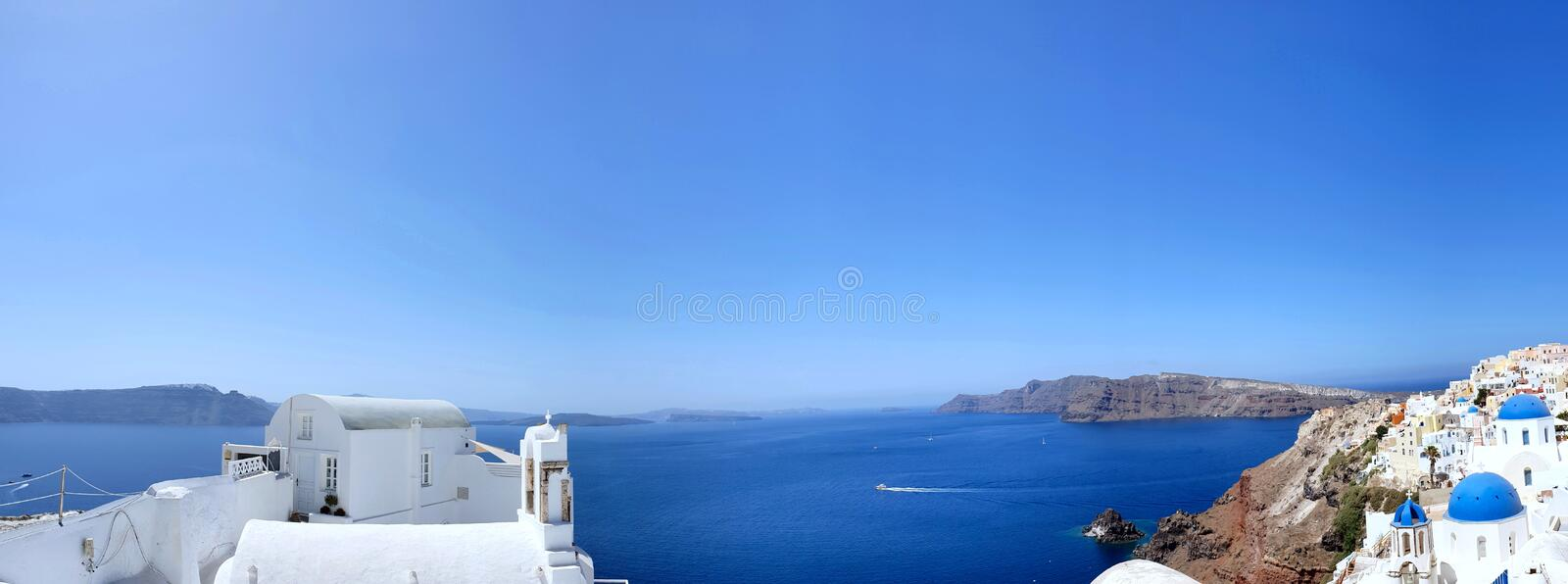 Beautiful aerial view of the city of Oia in Santorini, Greece. Beautiful city of Oia in Santorini, Greece with blue sky stock image