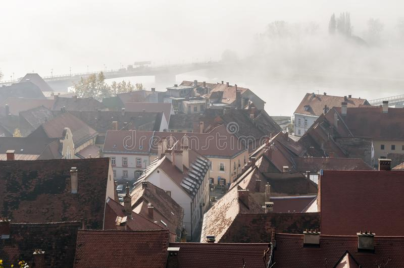 Beautiful aerial view of the historic center of Ptuj, Slovenia, wrapped in the morning fog royalty free stock photos