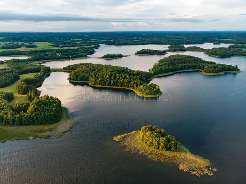 Beautiful aerial view of Moletai region, famous or its lakes. Scenic summer evening landscape in Lithuania royalty free stock photo