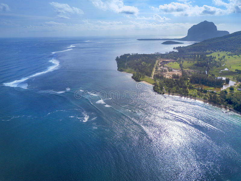 Beautiful aerial view of ocean and reef, Island of Mauritius. Beautiful aerial view of ocean and reef and mountain Le Morne on horizon, Island of Mauritius royalty free stock images