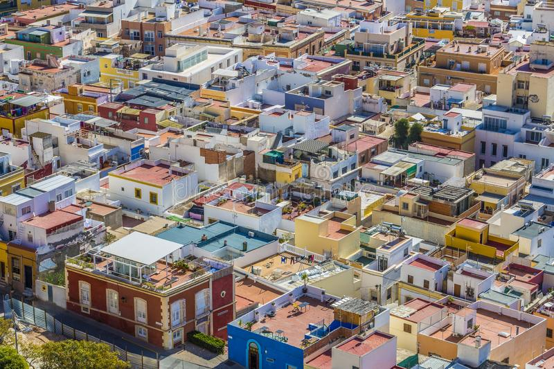 Beautiful aerial view of a part of the city of Almería observing the roofs. Of the houses painted with striking colors on a wonderful and sunny day in Spain stock photos
