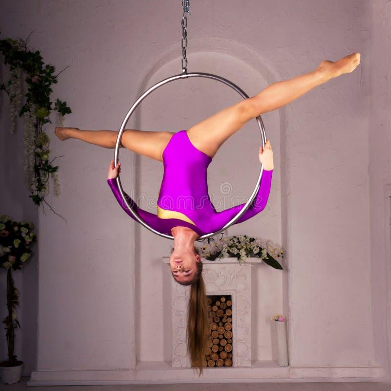 Girl training on aerial ring stock photo