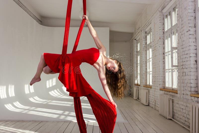 Girl training on aerial silks stock photography
