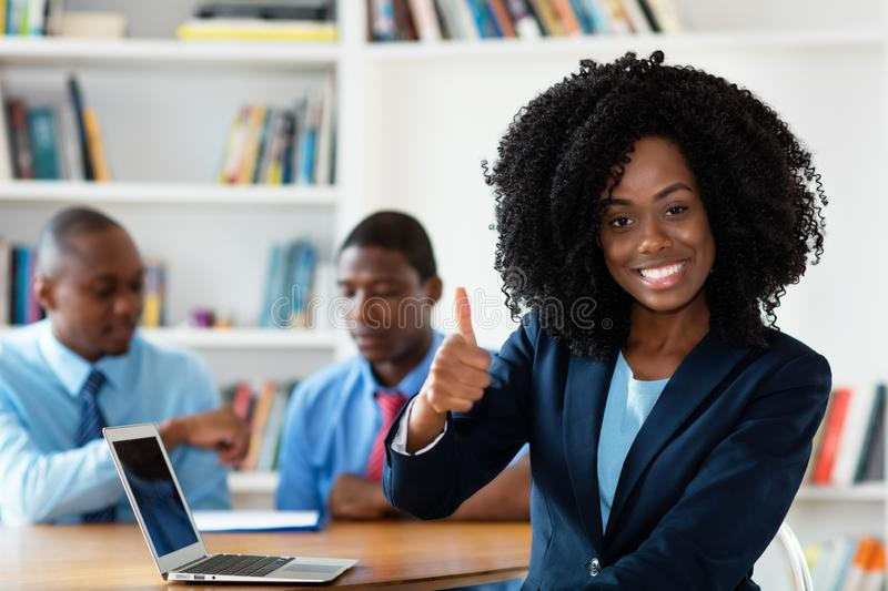 Beautiful african african businesswoman with business team royalty free stock images