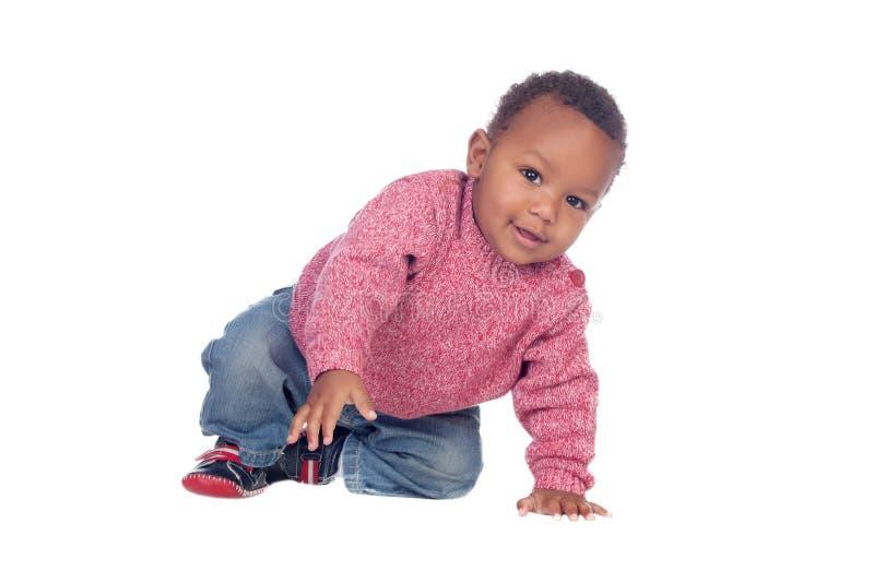 Beautiful African American baby crawling stock image
