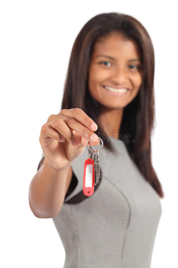 Beautiful african american businesswoman giving a home keys. Isolated on a white background royalty free stock image