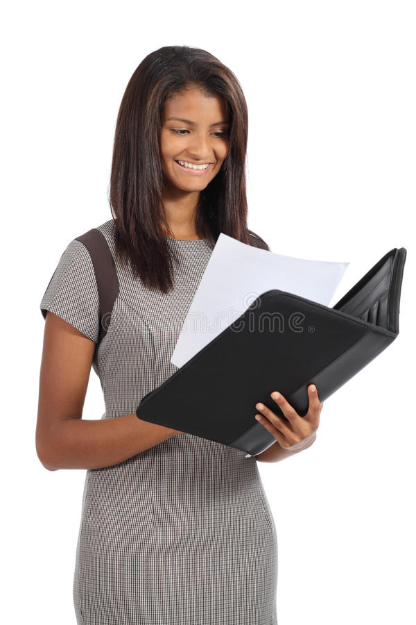 Beautiful african american businesswoman reading a report. Isolated on a white background stock image