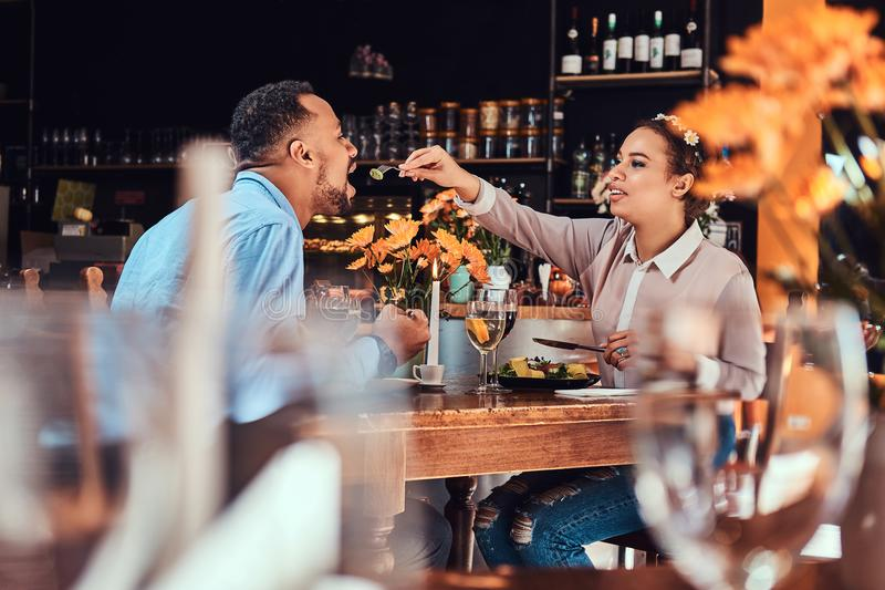 Beautiful African-American couple in love having a great time together at their dating, an attractive couple enjoying stock photos