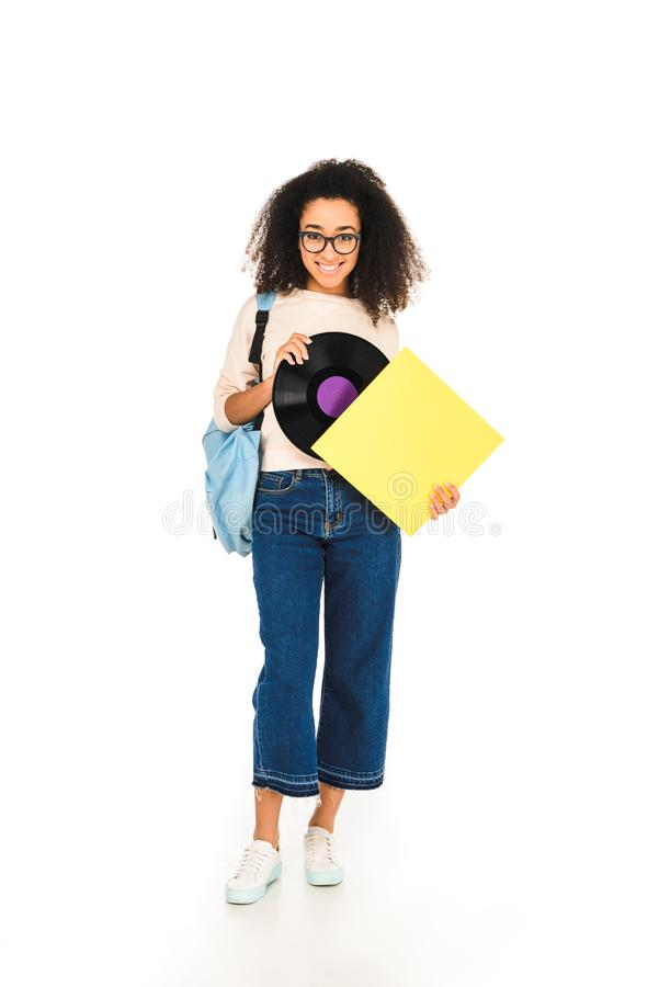 Beautiful african american girl standing with vinyl record isolated. On white stock photography