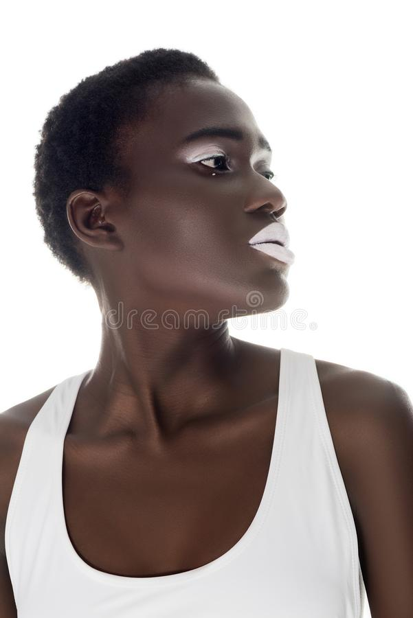 beautiful african american girl with white lips looking away royalty free stock images