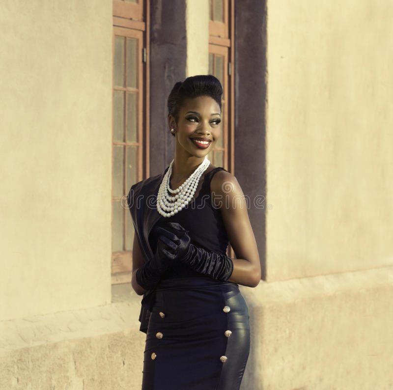 Beautiful African American model smiling turning head royalty free stock photos