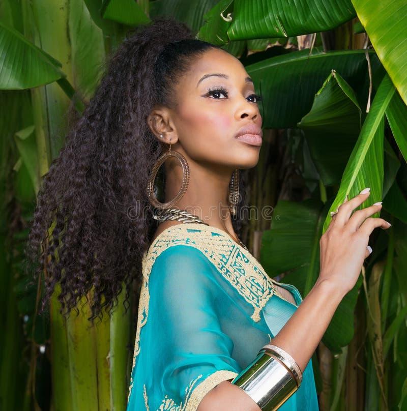 Beautiful African American model wearing tunic dress stock photos
