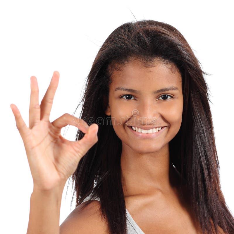 Beautiful african american model woman gesturing ok stock photos