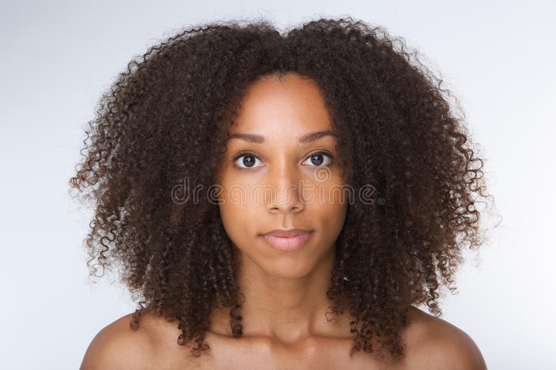 Beautiful african american young woman with curly hair stock photos