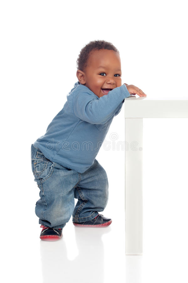 Beautiful african baby standig with a table royalty free stock photography