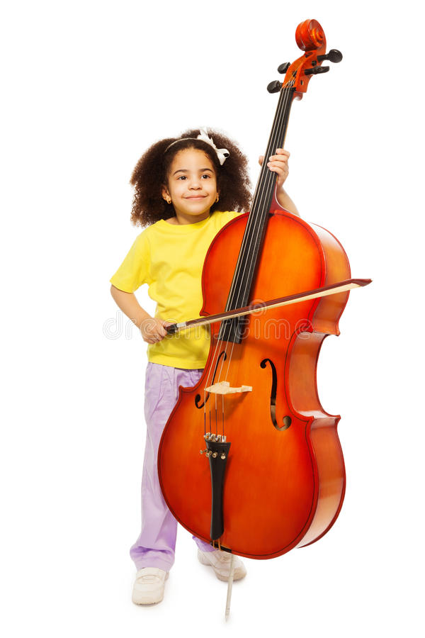 Beautiful African girl holds cello and fiddlestick royalty free stock photo
